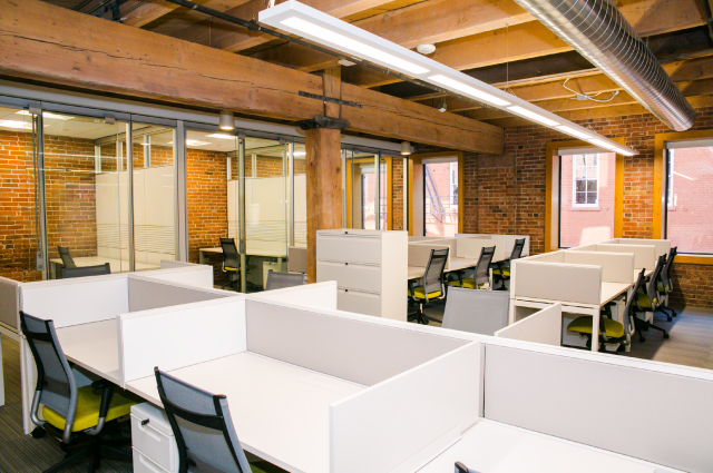 Office suite with multiple desks, and private rooms for tenants