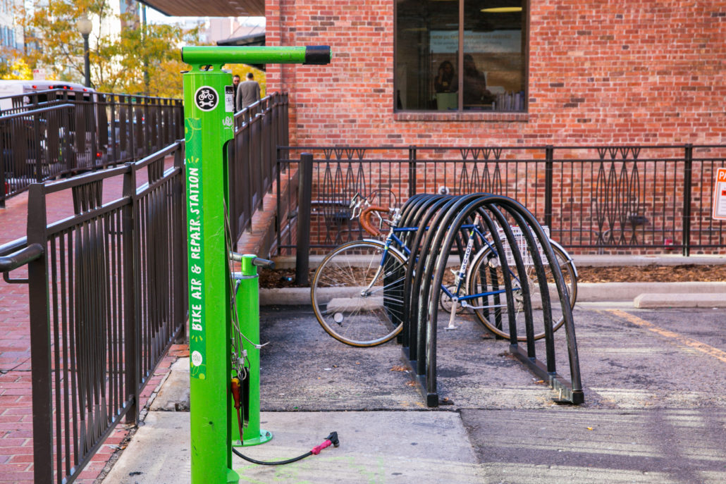 A bike rack and bike tools are pictured beside The Alliance Center