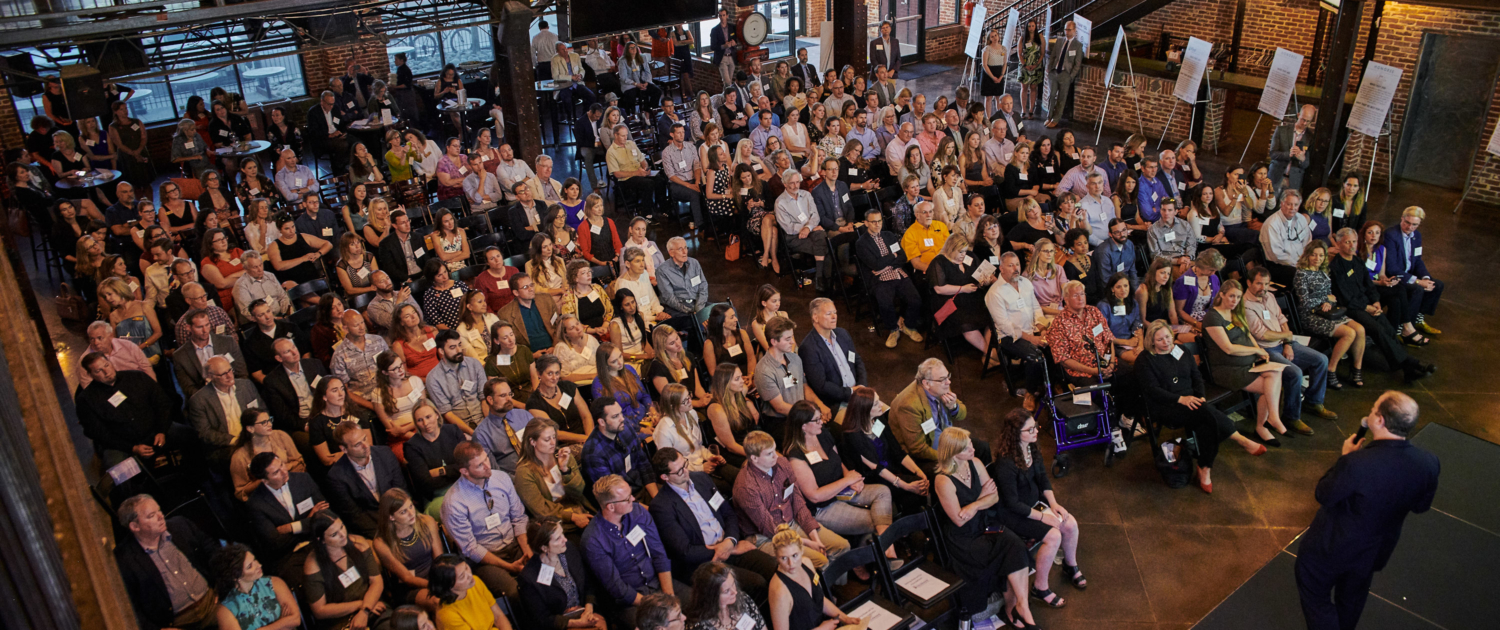 A birds eye view of Governor Polis and the audience at the 2019 Best for Colorado Awards Ceremony at Mile High Station