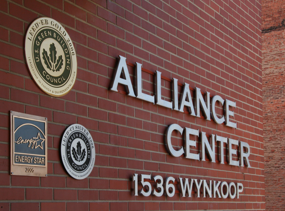 The exterior of The Alliance Center showing our LEED Gold, LEED Silver, Energy Star plaques along with our name and our address.