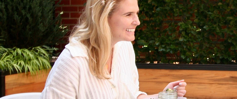 Lauren eats on The Alliance Center's patio
