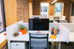 desk in denver coworking space with views of lodo
