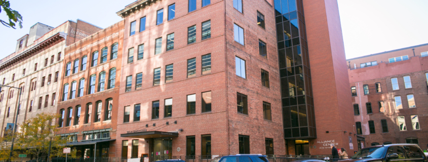 Photo of The Alliance Center exterior, a building with WELL Health-Safety rating. Brick building in LoDo.