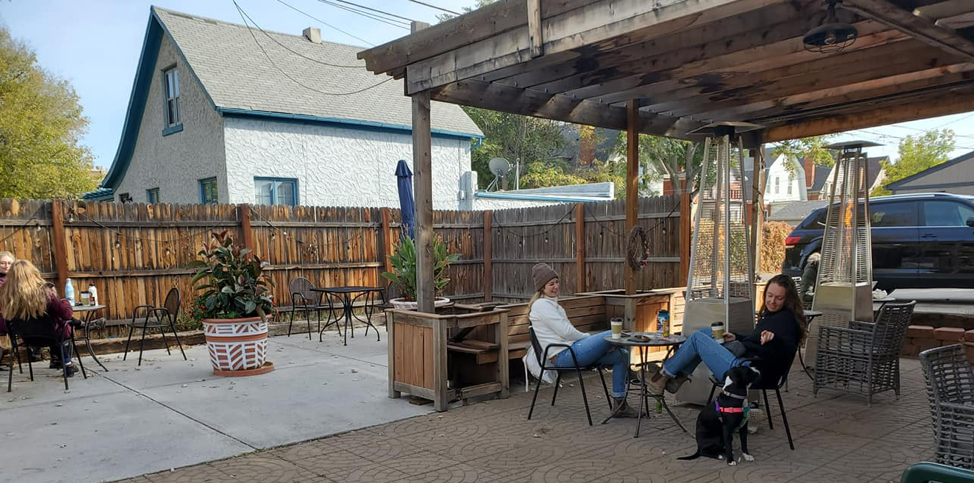 outdoor seating at whitter cafe, tables and heat lamps