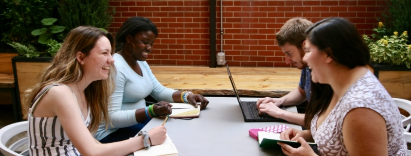 four people sitting at a table outside for internship supporting those who may have untraditional educational paths