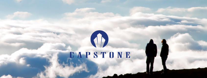 Logo for Capstone Investment Financial Group overlaid on mountain scene.