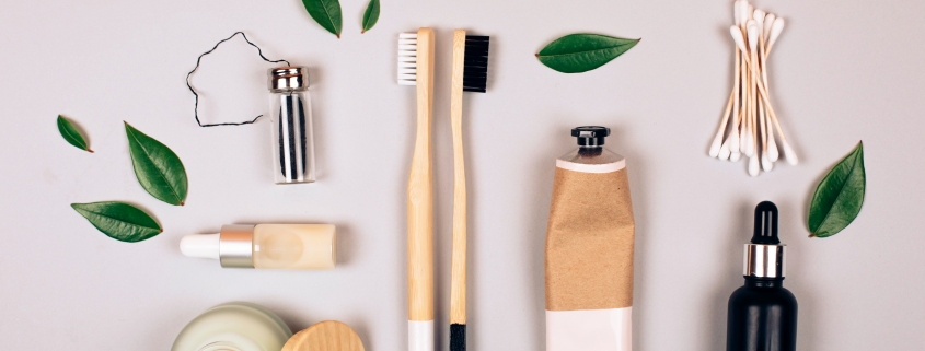 Zero waste self-care products. Bamboo toothbrush, toothpaste, tooth powder and flax. Flat lay style.