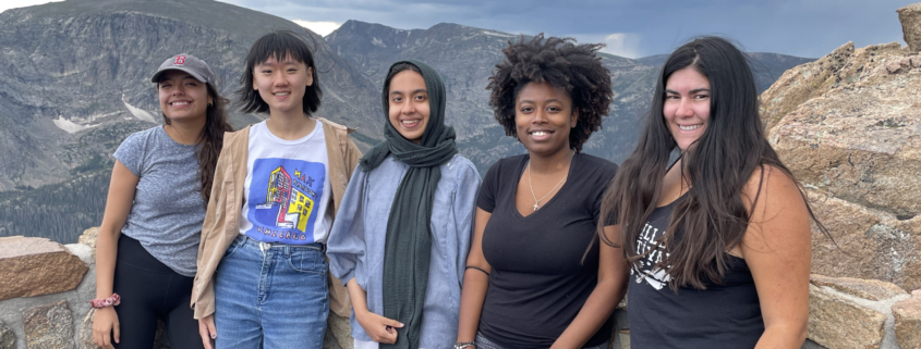 Five members of the SSI program together in the mountains
